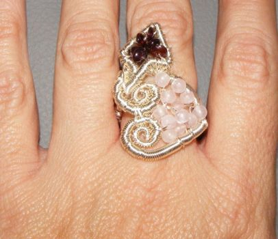Pierced Heart ring on finger by brillantcolors
