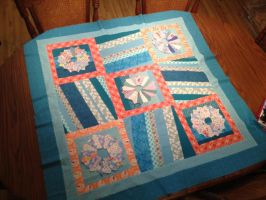 coral, aqua quilt WIP by tricksyriver