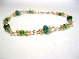 gold and green bracelet by faranway