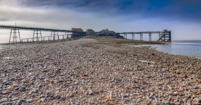 Birnbeck Pier at low tide by Vitaloverdose