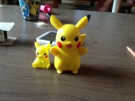 From right is talking Pikachu toy by pikatheking025
