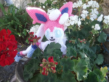 Sylveon hiding in flowers by FieryRei