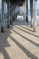 under the fishing pier at ocean city maryland by taevans