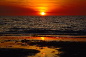 Sand, sea and sinking sun by wildplaces