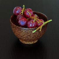 GRAPES IN COCONUT WOOD by martiuk