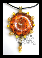 Sun Wheel Pendant by mnemosynestar