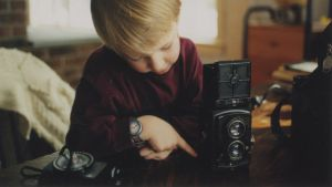 Six-year-old me with camera by timothymh