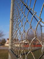 Chain Link and Concrete by Eisoptrophobic