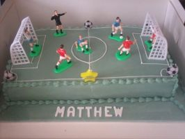 football pitch cake by starry-design-studio