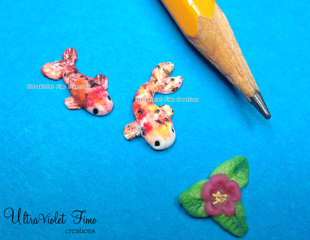Polymer Clay -tiny Fishes and a Water Lily by Crystarbor