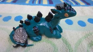 green and black stegosaurus for sale by ripple09
