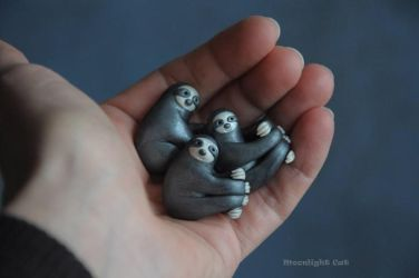 Happy sloth pendants by MoonlightCatHandmade