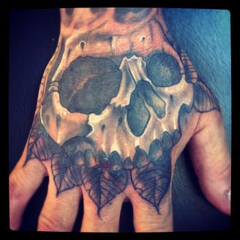 Skull on hand by WillemXSM