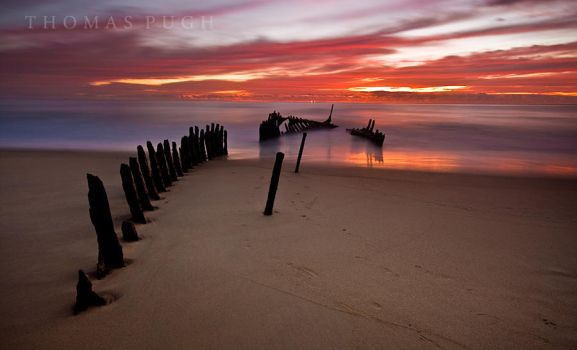 Red Sky Over The Wreck by eye-of-tom