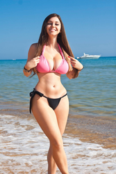 Smiling hourglass girl showing off her beach body by HipsLie