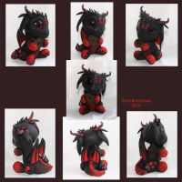 Red and Black Dragon with coin by BittyBiteyOnes