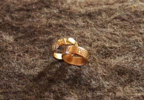 Brass and bronze rings by Dewfooter