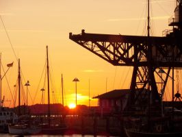 Sunset at the harbor Rostock by AnNacht
