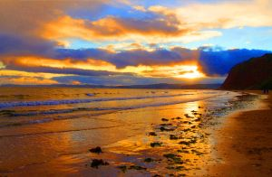 Sunset On Sandy Bay at Littleham Devon England by MarmaladePrints