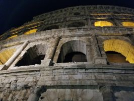 Flavian Amphitheatre (Colosseum) at Night by xechon