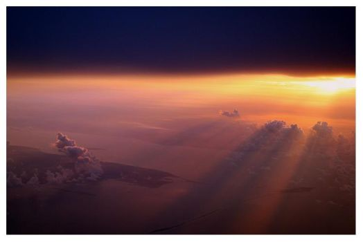 Sunrise from a plane by wickedhollow