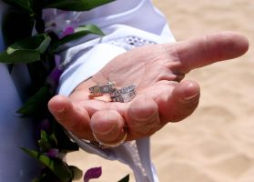 wedding rings on beach by CreativeConceptions