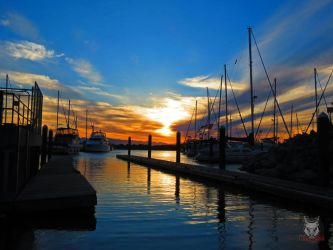 Blue And Gold Boat Launch Sunset by wolfwings1
