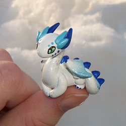 Frosty 'Thumb' Dragon by KingMelissa