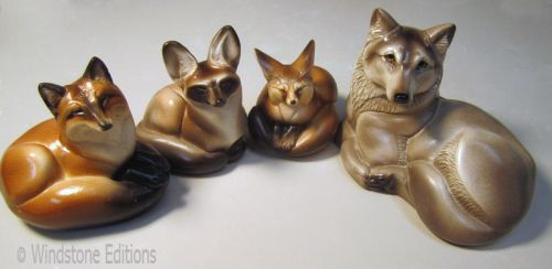 Pebble foxes by Reptangle