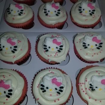 Strawberries and cream hello kitty cupcakes by MurcMarischal