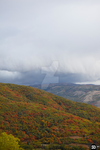 Storm front over the mountain side by SoulsofTheDoomed
