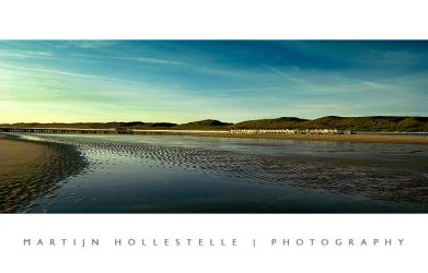 Low tide on an evening beach by Svision