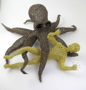 Octopus fighting man by CatsWire