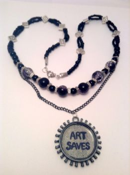 Art Saves beaded black and silver resin necklace by ArtAgainstSociety