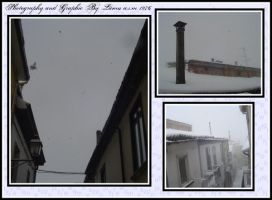 Snow falls on roofs by lamu1976