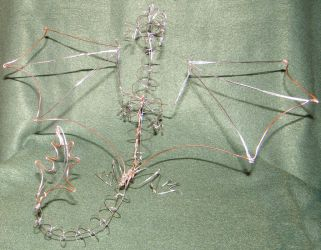 Wire dragon sculpture by floppybelly