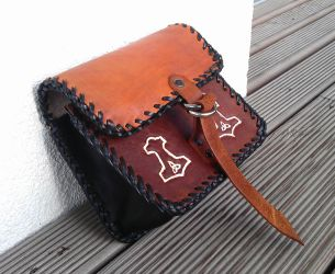 A small leather bag by A-Teivos