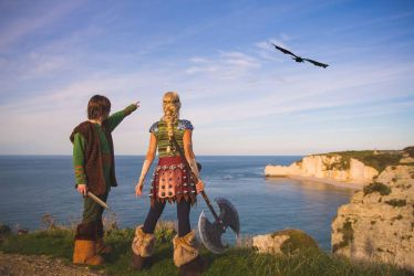 Astrid And Hiccup looking at Toothless by NatIvy