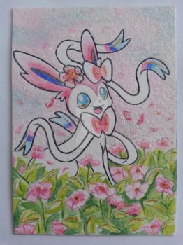Sylveon in a flowerbed by Pikabulbachu