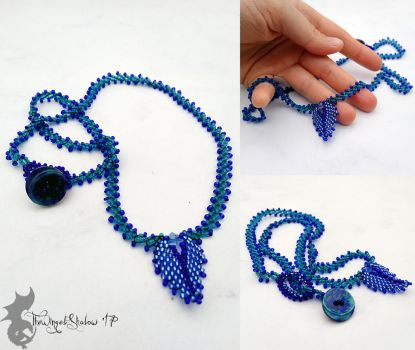 Blue Leaf Necklace by TheWingedShadow