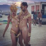 straight couple in gold at burning man 1 by TheMaleNudeStock