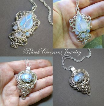 Two Moonstones set and wrapped in sterling silver by blackcurrantjewelry