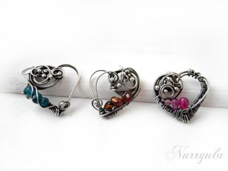 Silver heart necklaces with pretty gemstones by nurrgula