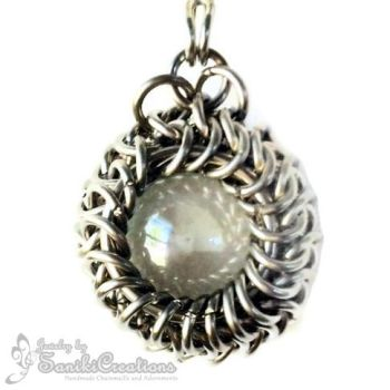 Chainmaille around a Marble pendant by sanikicreations