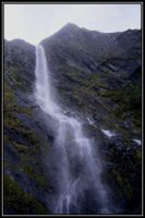 waterfall in the mountains by Macomona
