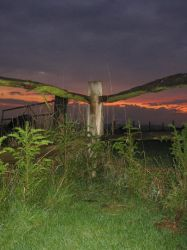 Sunset Behind the Fence by KimTyrrell