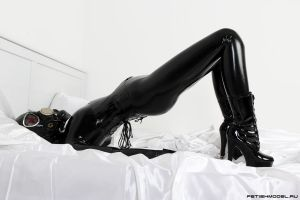 Black Latex Rubber Girl in a White Room. 27 by agnadeviphotographer