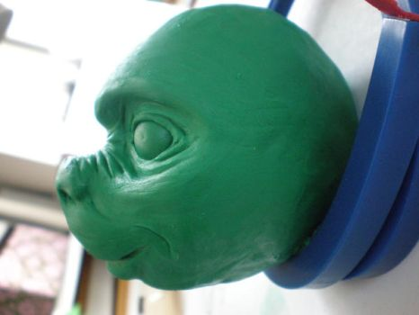 clay head front side by betani