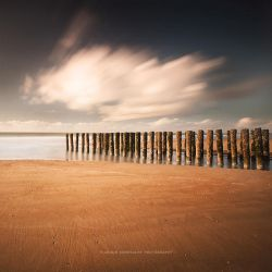 Sand, Logs and Clouds by soulofautumn87