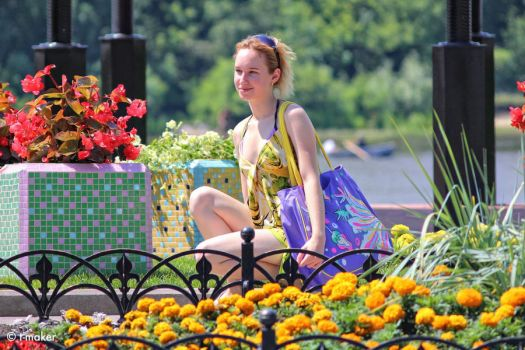 Girl near a flowerbed Updated by t-maker